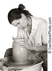 Potters art - Picture of a potter works a potters wheel...