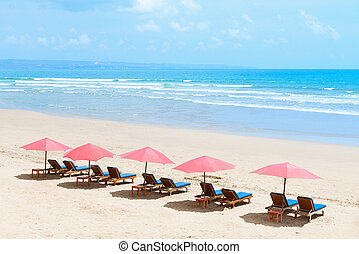 Tropical empty sandy beach with umbrellas - View of nice...