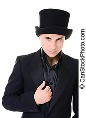Serious strick man illusionist in black - Serious strict man...