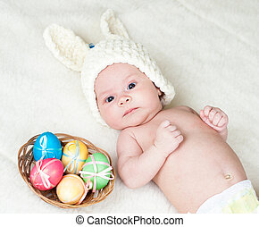 adorable baby dressed in Easter bunny cap