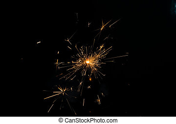 one christmas sparkler against the black background