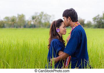 Couple Thai farmer on rice fields