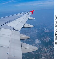 Aircraft wing on during flying above ground