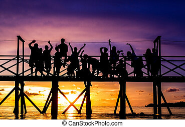 Large crowd of people against a sunset sky