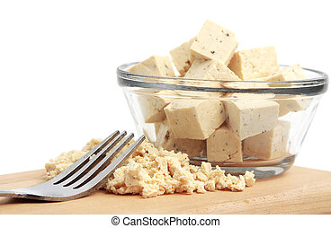 tofu - fresh fine herbs tofu in a bowl and wood plank with a...