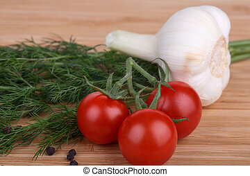 vegetables - fennel, tomatoes, hot peppers and garlic on a...