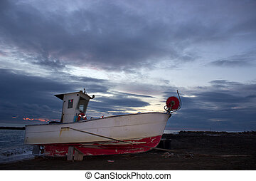 The old fishing boat - An aged fishing boat after a fishing...
