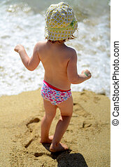 Child On A Beach - Soft Focus Lifestyle Image Of A Young...