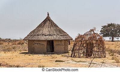 Village hut - A small village hut with Tatched roof on the...