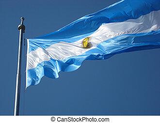 Argentina Flag on blue sky background.