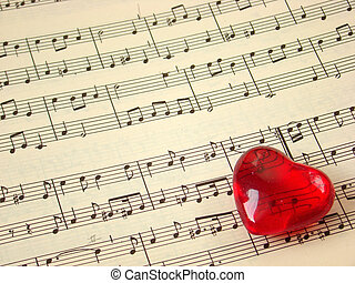 Music score and heart - Close up of a music score and a red...
