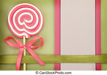 Blank banner with lollipop on green background