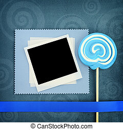 Photo frame and lollipop on blue background