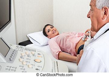 Female Going Through Abdomen Ultrasound