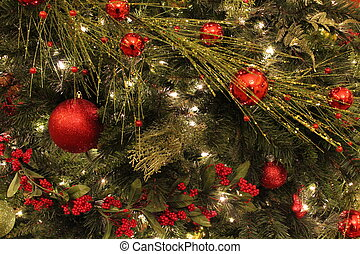 Holiday greenery with red ornaments - Holiday greenery of...