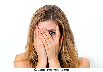 woman hiding face laughing timid on white background