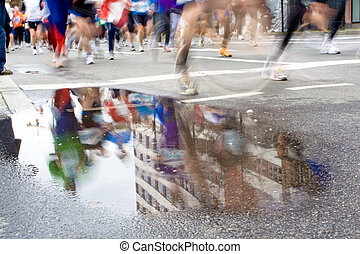 Marathon racers - Group of top marathon racers reflection in...