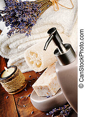 Spa setting with natural soap and lavender on wooden table