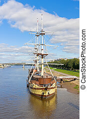 Old ship at the pier. Russia, Novgorod.