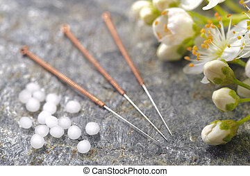 homeopathy and acupuncture - alternative medicine with...