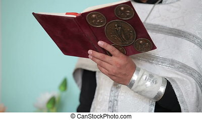 Priest with Bible in hands