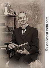 Sepia portrait of man reading the book Intentional 1900s...