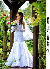 Bride with bouquet outdoors