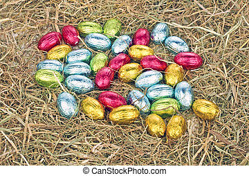 Little colored eggs in straw