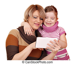 mother and daughter play with tablet pc on white