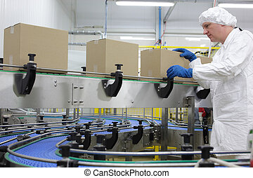 worker at packing line in factory - caucasian man worker in...