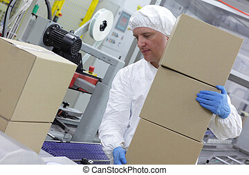 worker at packing line