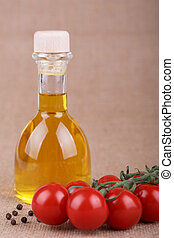 oil in bottle - oil in a bottle with tomato on sacking...