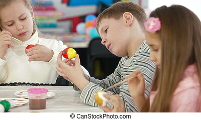 Kids Painting Easter Eggs - Children painted Easter eggs in...