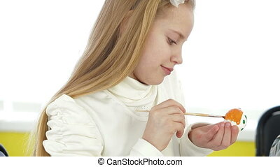 little girl painting easter eggs - blonde little girl...