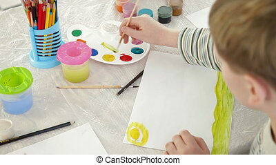 child drawing in watercolor