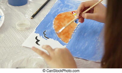 Child Drawing - little girl drawing in watercolor sea and...