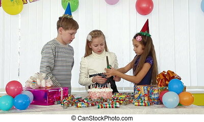Childrens Birthday Party - Three kids during birthday party,...