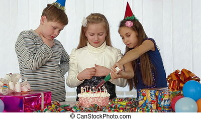 children blowing candles on birthday cake, Medium Shot