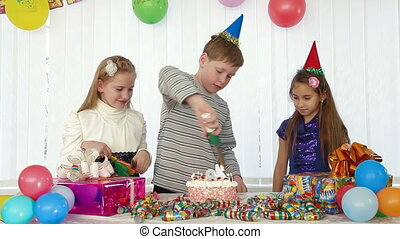Birthday Cake - children blowing candles on birthday cake