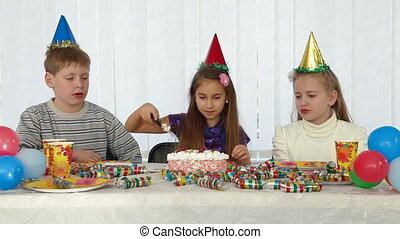 Kids Birthday Party - birthday girl cutting cake and and...