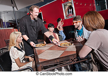 Hipsters Eat at Mobile Cafe - Hipster group served pizza by...