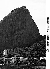 View of buildings with the Sugar Loaf from a boat at Baia de...