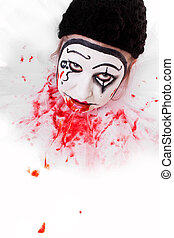 Fearsome clown in front of white background with space for...