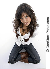 sexy teenager sitting on floor with legs crossed with white...