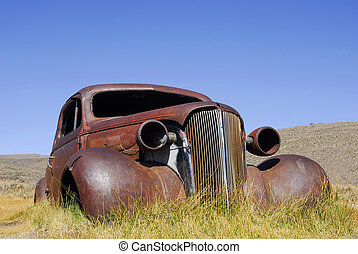 Abandoned Antique Car - A rusted out hulk of a vintage car...