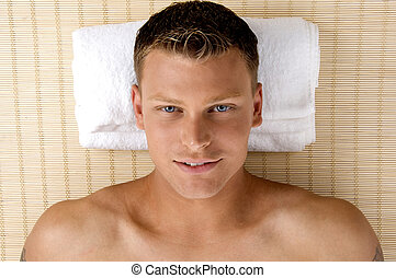 man relaxing in a spa salon