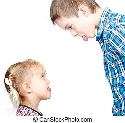 Children sticking out tongues - Sister and brother stick out...