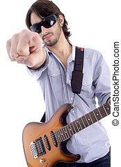 young rock star posing with guitar on an isolated white...