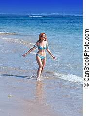 The young attractive woman on a beach