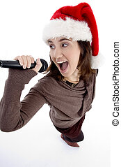 teen singer with mic and christmas hat - teen singer with...